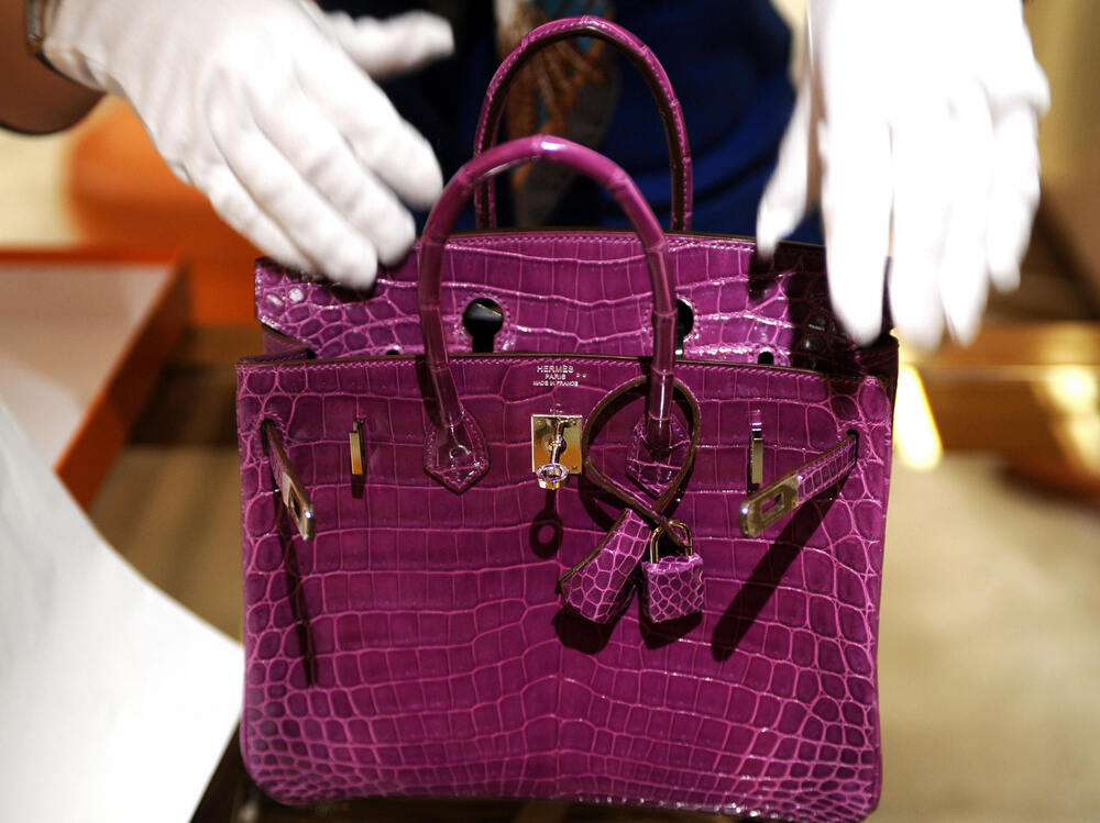 The Birkin Croco is made of dyed crocodile skin.