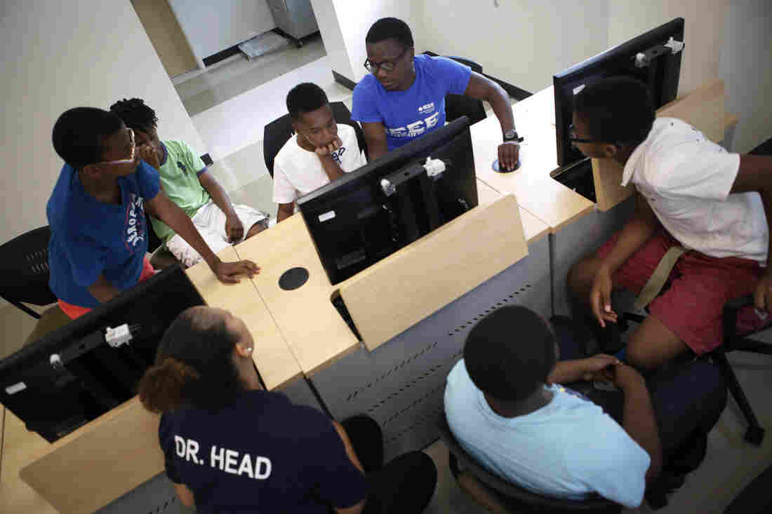 Current Morgan State students work as teaching aides and mentors.