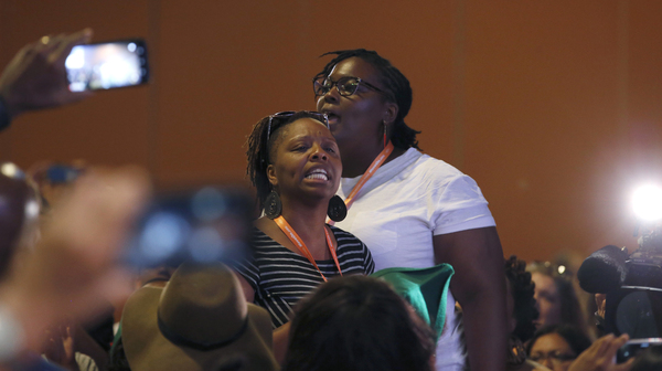 "Black Lives Matter activists confronted Democratic candidates Martin O'Malley and Bernie Sanders at a Netroots Nation event earlier this month. O'Malley used the phrase ""all lives matter"" twice, which he later apologized for."