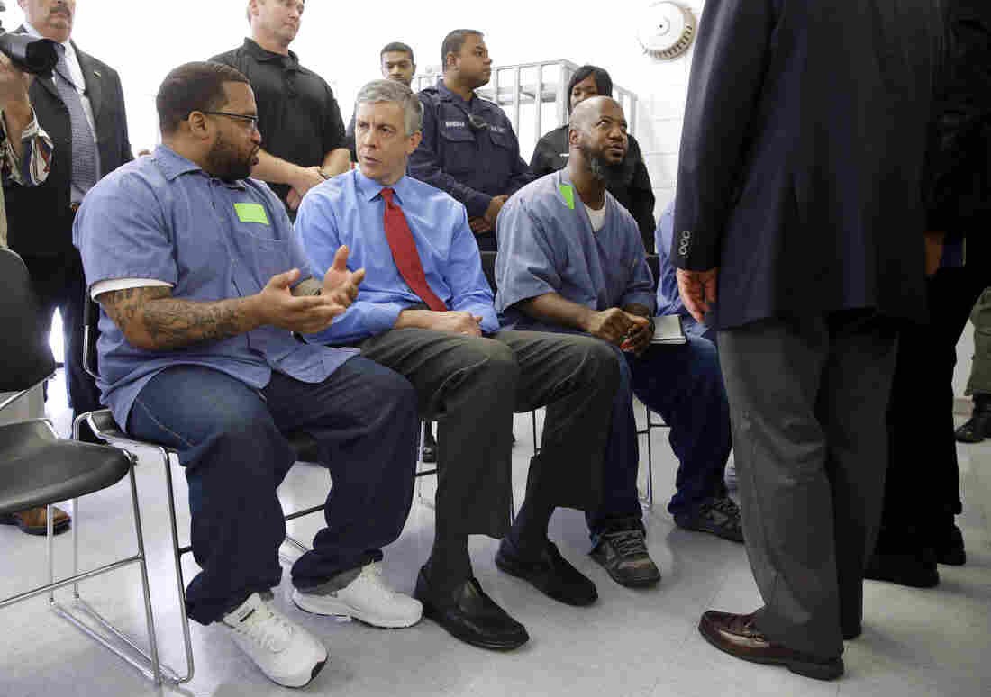 Education Secretary Arne Duncan (second from left) speaks with inmate Terrell Johnson, a participant in the Goucher College Prison Education Partnership.