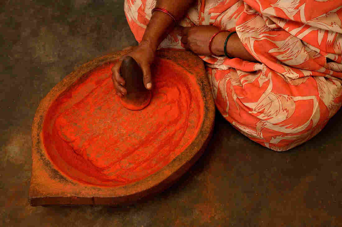 A woman prepares bhasma ingredients for an Ayurvedic treatment in India. Ayurveda is also used in the United States.