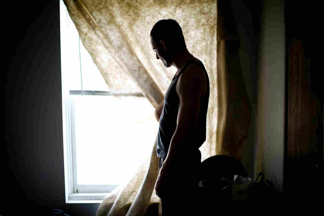 Daniel Harmon, a veteran of the wars in both Afghanistan and Iraq, looks out the window of his room at the Hollywood Veterans Center in Los Angeles. The facility provides housing to homeless vets.