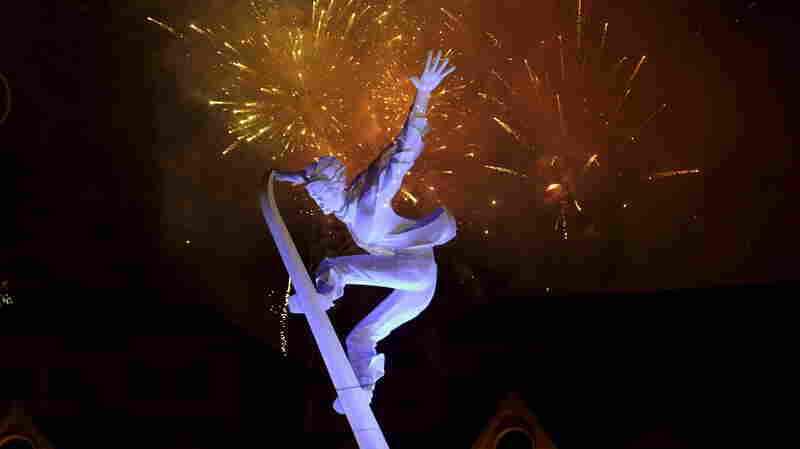 Fireworks explode behind a skiing sculpture to celebrate Beijing being chosen to host the 2022 Winter Olympics last week.