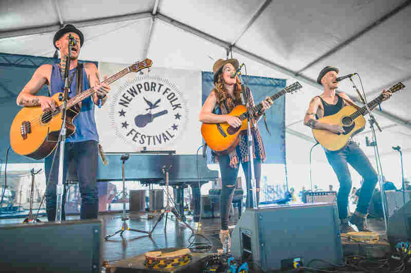 Brandi Carlile and Phil and Tim Hanseroth perform at the 2015 Newport Folk Festival.