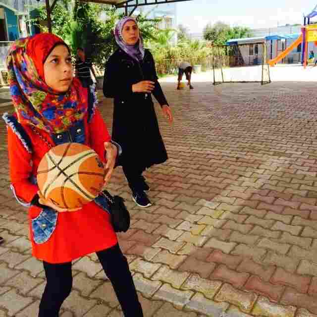 Girls plays basketball at a school for nearly 2,000 Syrian refugees in Reyhanli, in southern Turkey. The schools, which depends on private donations, is struggling to remain open. The students attend in five separate shifts throughout the day.