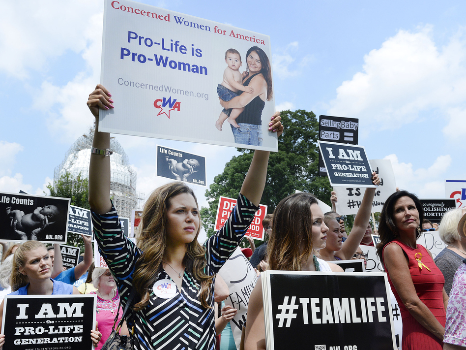 Anti-abortion activists hold a rally opposing federal funding for Planned Parenthood in front of the U.S. Capitol on July 28 in Washington, D.C. (Olivier Douliery/Getty Images)
