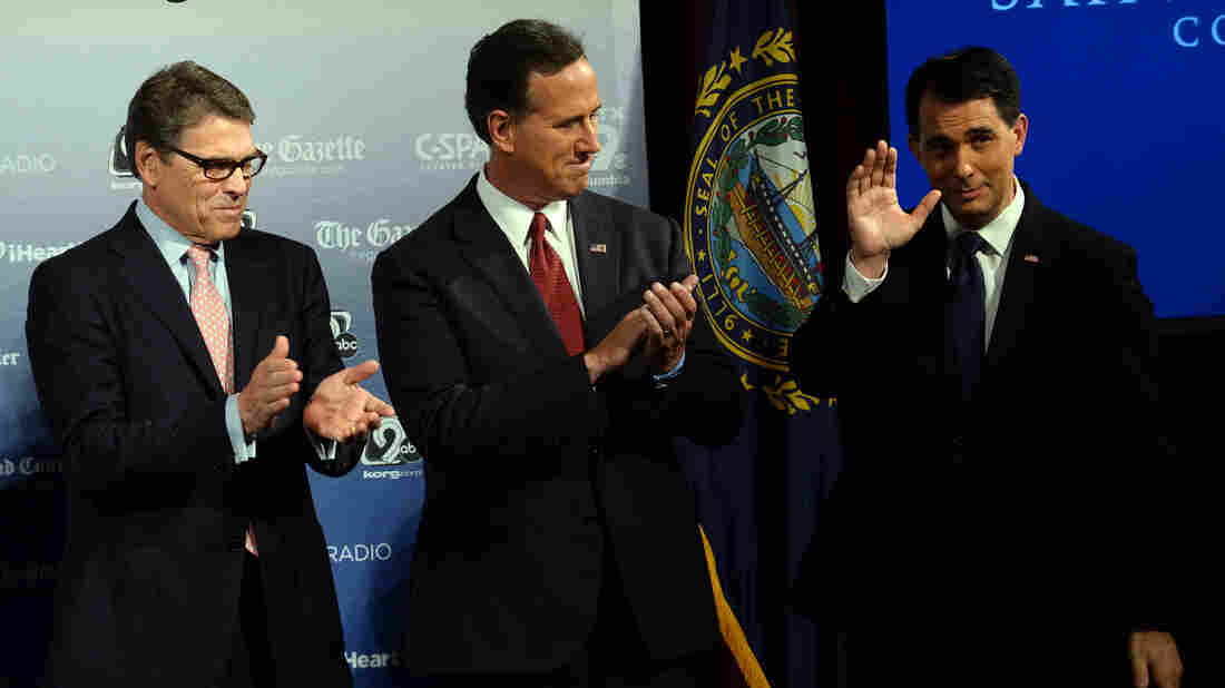Former Texas Gov. Rick Perry, left, former Sen. Rick Santorum, center, and Wisconsin Gov. Scott Walker on stage before a candidate forum in New Hampshire earlier this week.