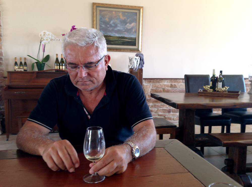 Petros Hatzigeorgiou, whose family has been making wine for more than 150 years, at his winery outside the village of Atsiki, Lemnos. He says islanders can weather the tax by working harder.