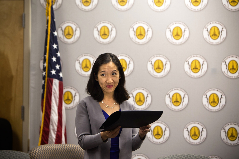 Leana Wen hands out awards to business owners for their efforts to support breastfeeding at the Baltimore City Health Department on Tuesday. (Meredith Rizzo/NPR)
