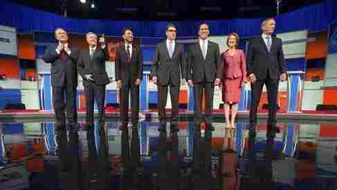 Republican presidential candidates from left, Jim Gilmore, Lindsey Graham, Bobby Jindal, Rick Perry, Rick Santorum, Carly Fiorina, and George Pataki take the stage for a pre-debate forum at the Quicken Loans Arena, Thursday, Aug. 6, 2015, in Cleveland. Seven of the candidates have not qualified for the primetime debate.