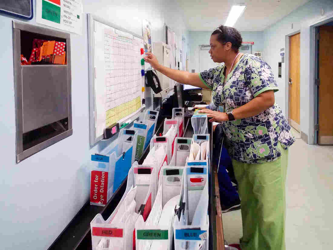 Nursing attendant Tracie Bell helps manage patients at the ophthalmology clinic at Los Angeles County Harbor-UCLA Medical Center. The clinic created a color-coded system to reduce wait times for patients.