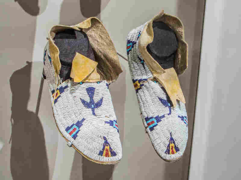 The wearer of these moccasins would be blessed with power flowing from a sacred mountain, and blessed by the assistance of a sacred bird who carried his petitions above.