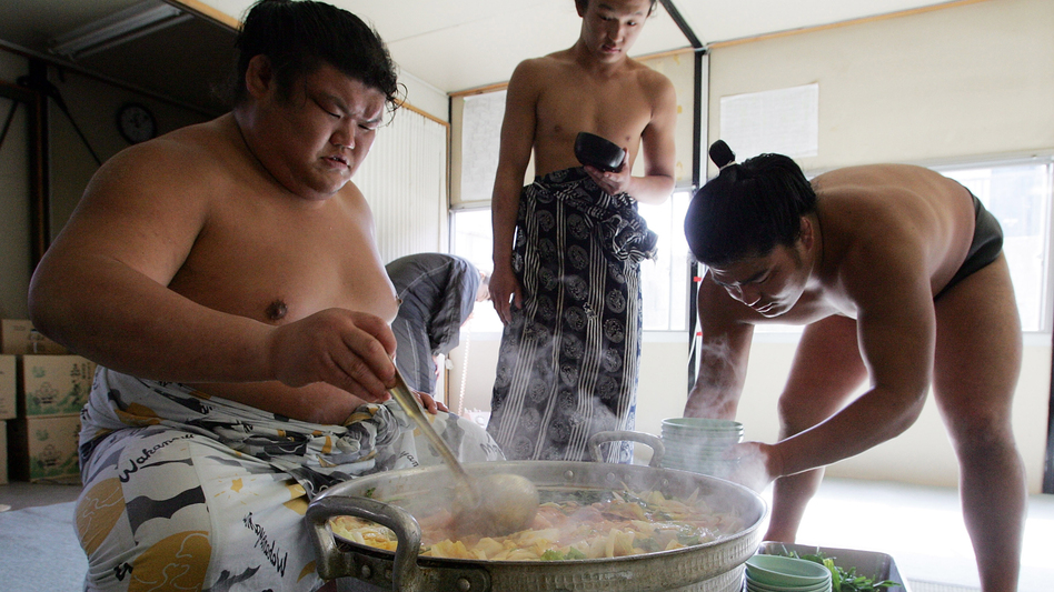 Sumo wrestlers serve up chanko-nabe at Musashigawa Sumo Stable in 2007 ...