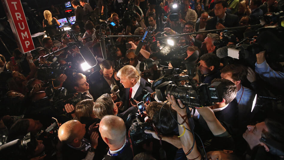 Donald Trump talks to reporters after Thursday's debate. (Scott Olson/Getty Images)