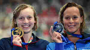 Gold medalist Katie Ledecky (left) of the United States poses with silver medallist Federica Pellegrini of Italy during a medal ceremony at the FINA World Championships in Kazan, Russia.
