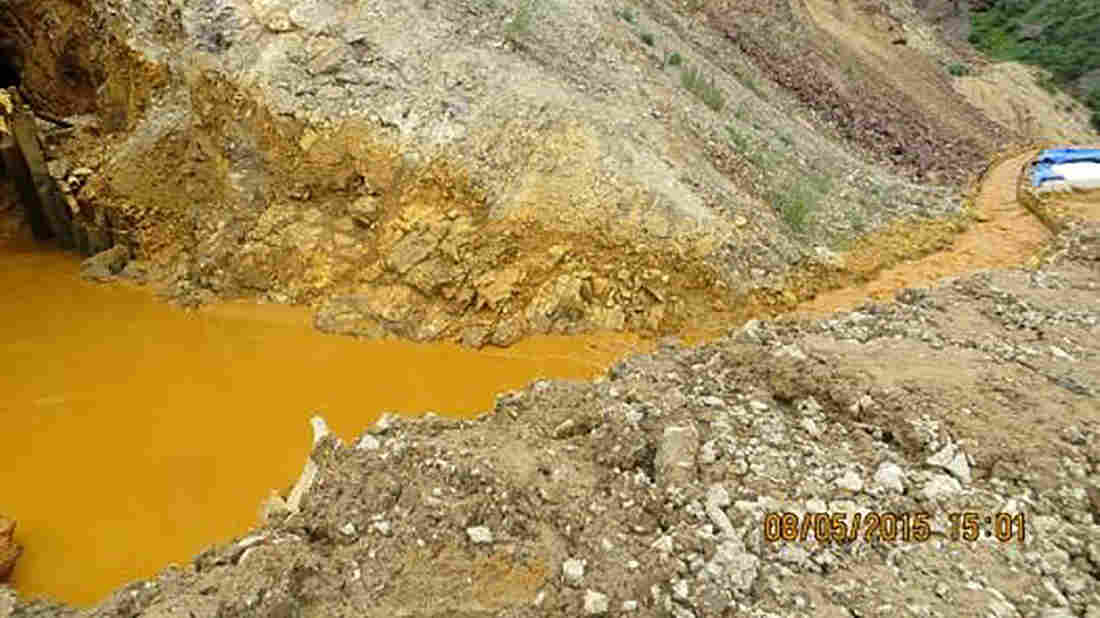 Contaminated wastewater is seen at the entrance to the Gold King Mine in San Juan County, Colo., in this picture released by the Environmental Protection Agency. The photo was taken Wednesday; the plume of contaminated water has continued to work its way downstream.