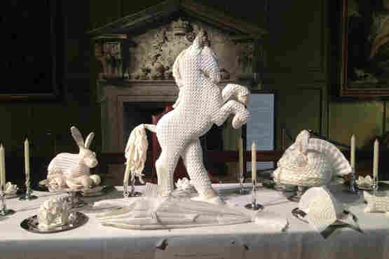 Though today we see these folded sculptures as simple decoration, 16th century guests would have been well aware of the symbolism behind each choice. These examples of napkin art were on display at Hampton Court Palace outside London in 2014.