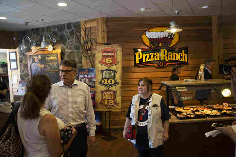Former Texas Gov. Rick Perry greets Iowans at Fort Dodge Pizza Ranch in July.