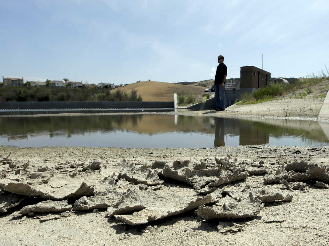 Rich Kissee, operations manager for the Santa Margarita Water District, stands on the edge of a water runoff reservoir in Rancho Santa Margarita, Calif.