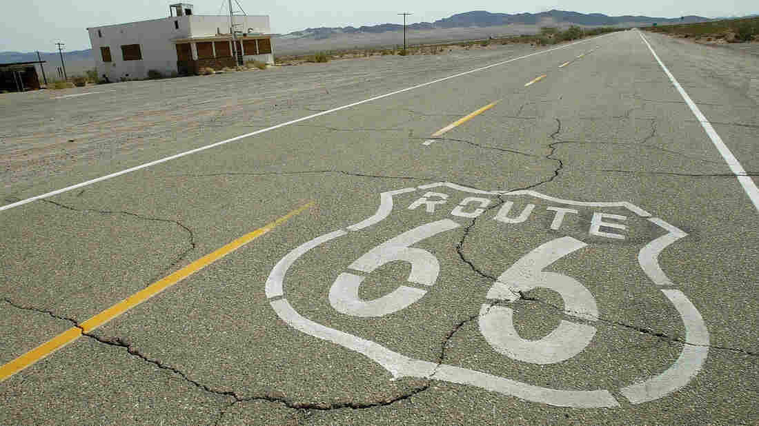 Route 66 is stenciled on the old road through an abandoned town in California's Mojave desert 14 July 2003.