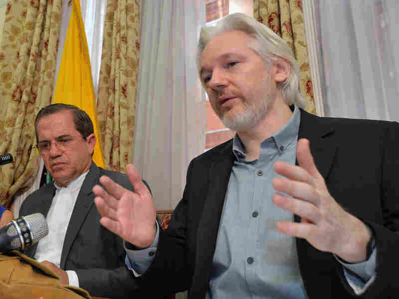 Ecuadorean Foreign Minister Ricardo Patino (left) and WikiLeaks founder Julian Assange speak during an August 2014 news conference inside the Ecuadorean Embassy in London.