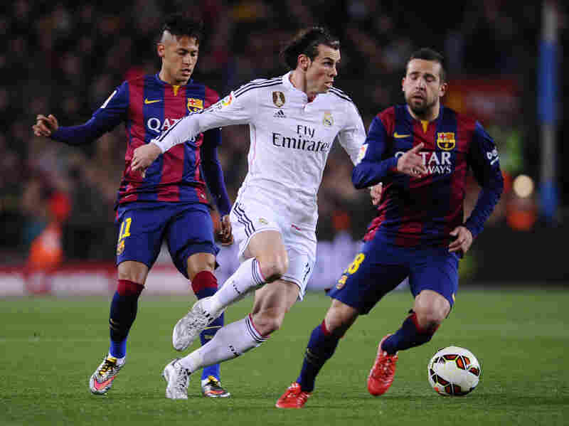 Real Madrid's Gareth Bale (center) tries to get past Barcelona's Neymar (left) and Jordi Alba during the last Clasico match at Camp Nou stadium on March 22 in Barcelona.