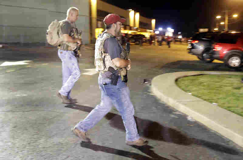 """Heavily armed civilians with a group known as the Oath Keepers in Ferguson, Mo., early Tuesday. St. Louis County Police Chief Jon Belmar has said the presence of the group was """"both unnecessary and inflammatory."""""""