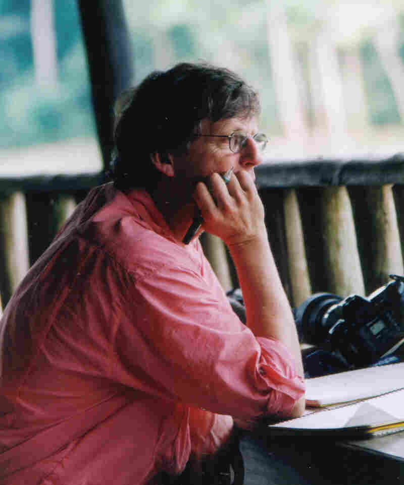 Christopher Clark, a Cornell University senior scientist, shown here in the Central African Republic helping with the Cornell Lab's Elephant Listening Project in 2002, also has spent many years recording whale sounds.