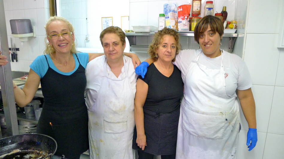Itziar Eguileor (left), head cook at Restaurante Berrio, poses with the rest of the kitchen staff at their eatery in Galdakao, Spain. The staff used to throw away several pounds of leftover food each night, but now they haul it over to the Solidarity Fridge, Spain's first communal refrigerator, that's designed to cut down on food waste.