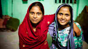 Minu (left) and her younger sister Shumi (right) worked on the Planet Money men's t-shirt.