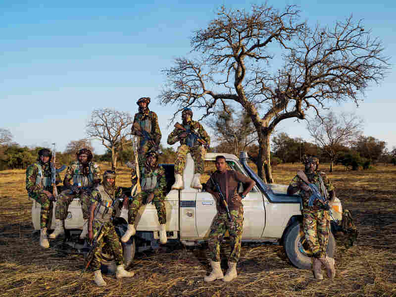 "Zakouma's Mamba Team 1 anti-poaching unit includes driver Issa Adoum (brown shirt). After Sudanese poachers killed his ranger father, Adoum refused diya, a traditional community payment. ""Diya is for accidents,"" he says."