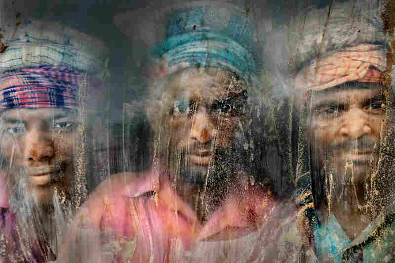 Second place: Three gravel workmen look through a window at their workplace in Chittagong, Bangladesh. Dust and sand are everywhere.