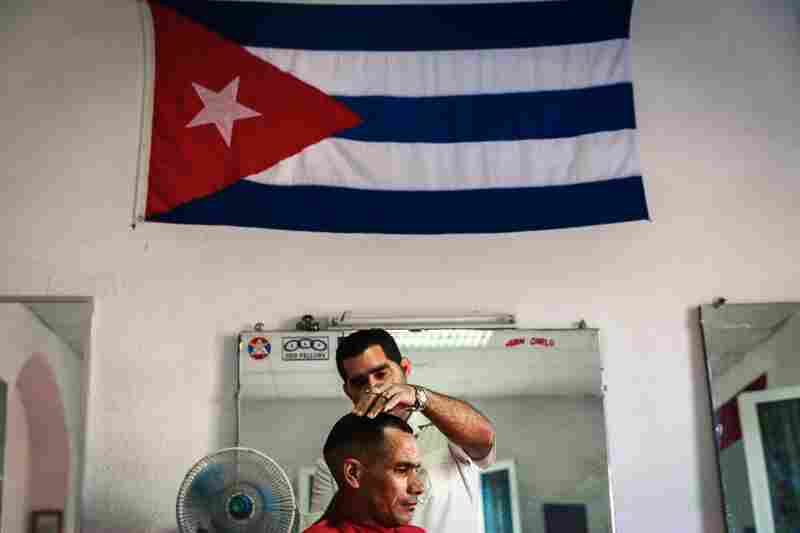 The national flag is a fixture in this Cuban barbershop.