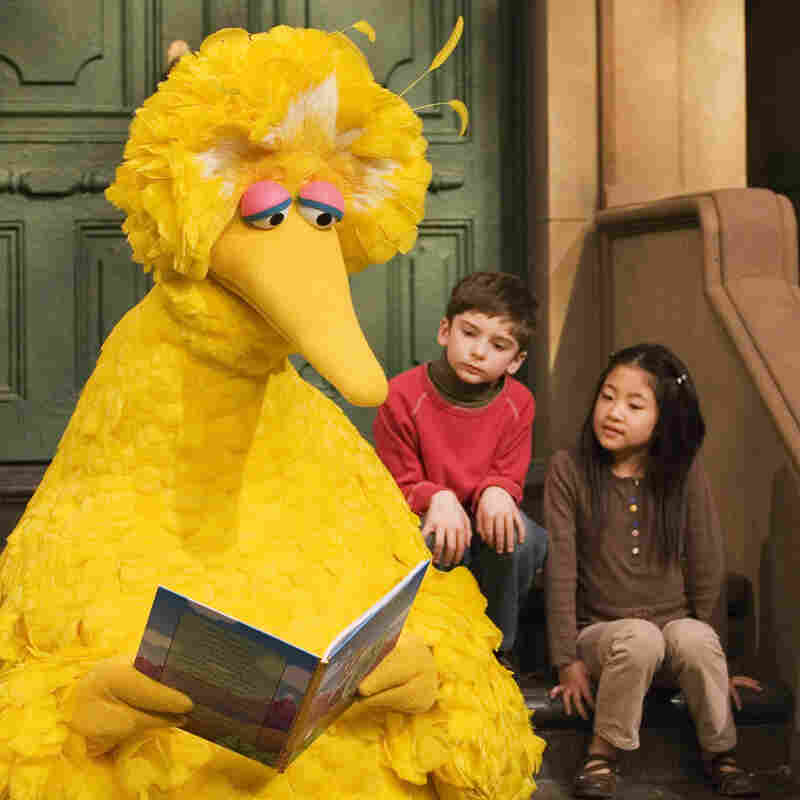 Big Bird, played by puppeteer Caroll Spinney, reads to Connor Scott and Tiffany Jiao during a taping of Sesame Street in 2008 in New York.