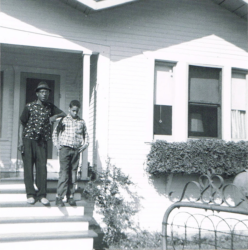 Author Walter Mosley in front of his childhood home in the LA neighborhood of Watts. He's standing with his father. (Courtesy of Walter Mosley)