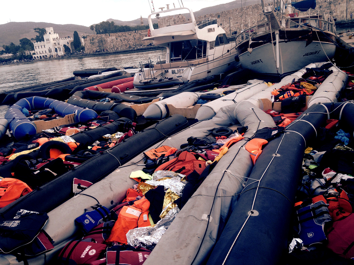 Dozens of rafts used by by refugees and migrants, mainly from Syria, Afghanistan and Iraq, to cross from the Turkish coastal district of Bodrum to the Greek island of Kos, sit empty by the seashore.