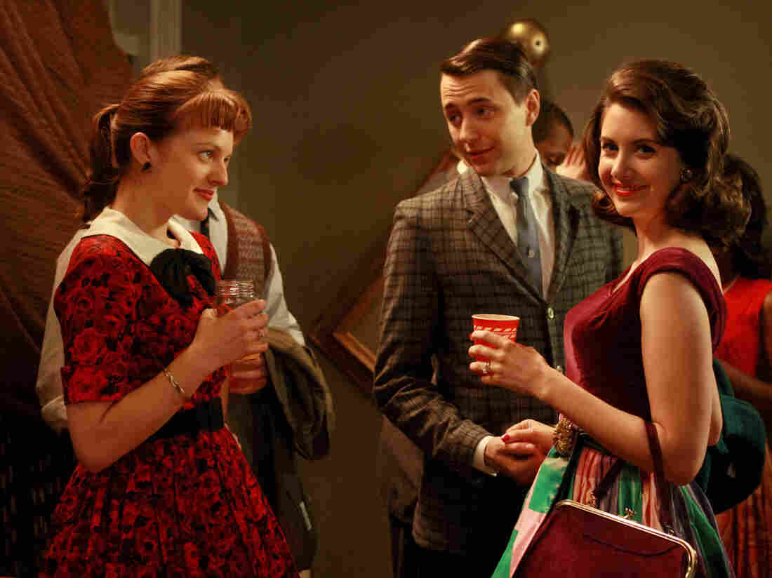 Alison Brie (right) as Trudy Campbell on Mad Men.