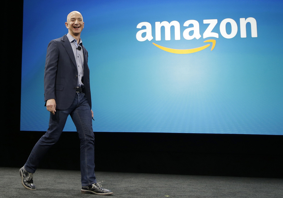 Amazon CEO Jeff Bezos appears at an event last year in Seattle for the launch of the new Amazon Fire Phone. (Ted S. Warren/AP)