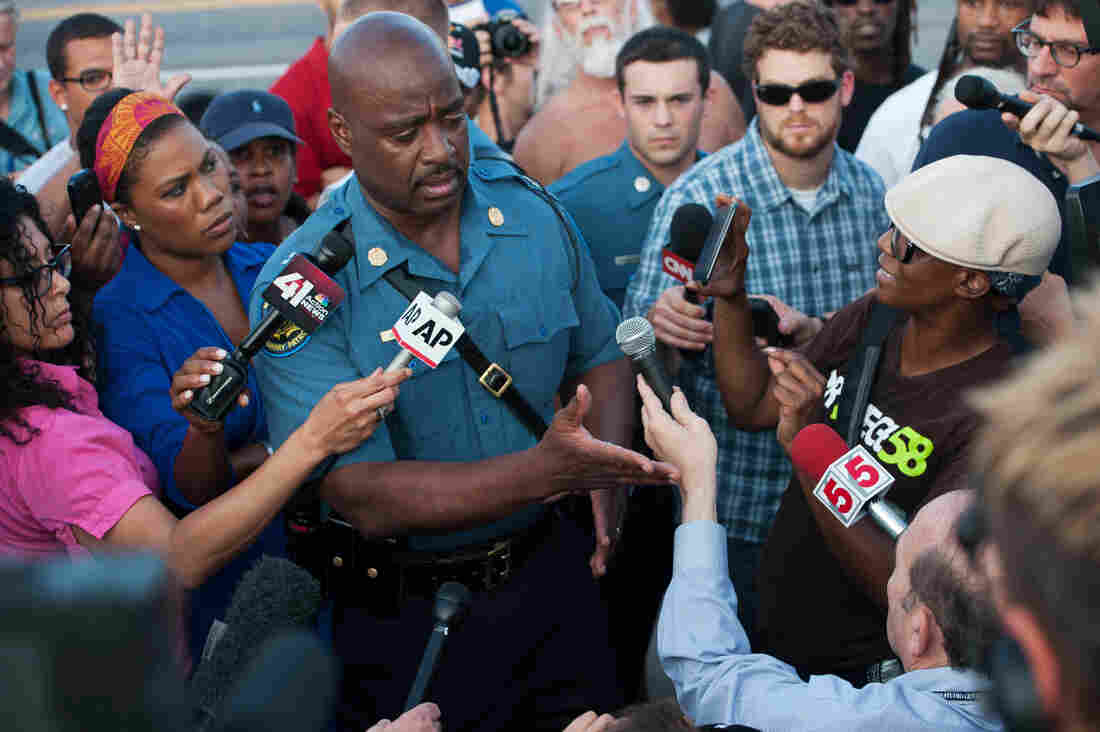 Capt. Ron Johnson of the Missouri State Highway Patrol answers media questions at their holding pen in Ferguson on Aug. 19, 2014.