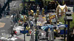 Investigations continue at the Erawan Shrine the morning after an explosion in Bangkok. Thailand's prime minister promised on Tuesday that authorities would quickly track down those responsible for the bombing.