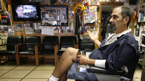 Thomas Checkler, owner of The Old Village Barber in Worthington, Ohio, discusses the impact that the barrage of political ads have on him and his customers during the 2012 presidential election campaign.