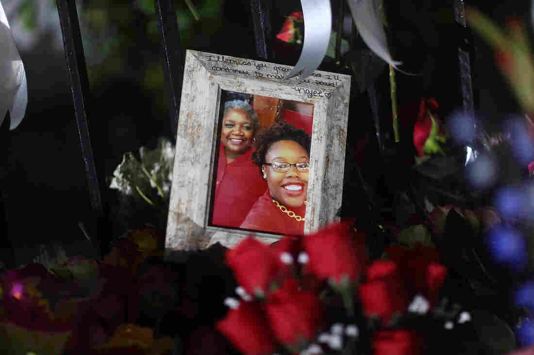 A family photograph among the memorials on the sidewalk in front of the Emanuel African Methodist Episcopal Church in Charleston, S.C., after a racially motivated mass shooting there on June 20.