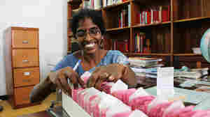 "Librarian S. Kalaivani has worked at the Jaffna Public Library in Sri Lanka for five years. ""I love working here,"" she says. ""It's a pleasure to help the people who are continuing to get knowledge."""