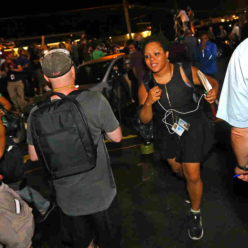 Yamiche Alcindor runs down West Florissant Ave., early morning on Aug. 20, 2014, in Ferguson, Mo.