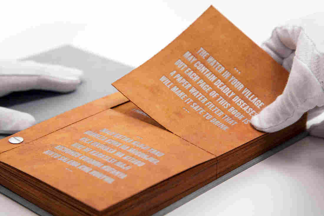 Tear out a page from The Drinkable Book and pour water through it. The built-in filter can wipe out bacteria.