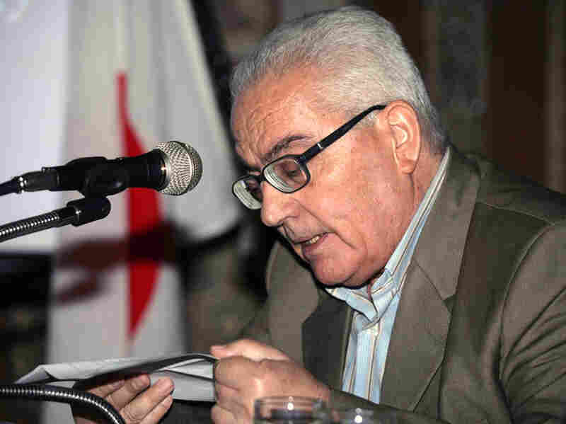 One of Syria's most prominent antiquities scholars, Khaled al-Asaad, speaks in this undated photo released by the Syrian state media.