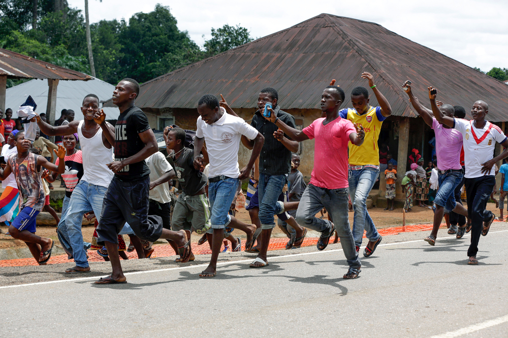 A celebration erupts in the streets of the Massessehbeh village on Friday, after President Ernest Bai Koroma officially ended Sierra Leone's largest remaining Ebola quarantine.