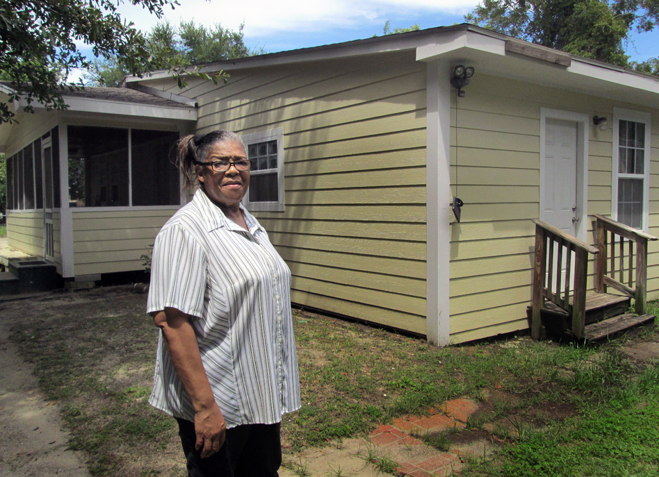Mississippi resident Ethel Curry stands in front of her East Biloxi home, which was rebuilt with the help of volunteers after Hurricane Katrina. (Evelina Burnett/MPB)