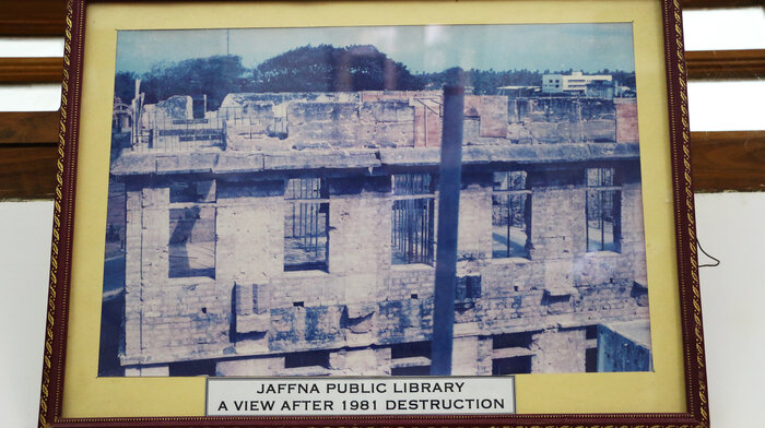 This framed picture depicts the library in 1981, after it was destroyed in a fire that Sri Lankan Tamils suspect was set by government police.
