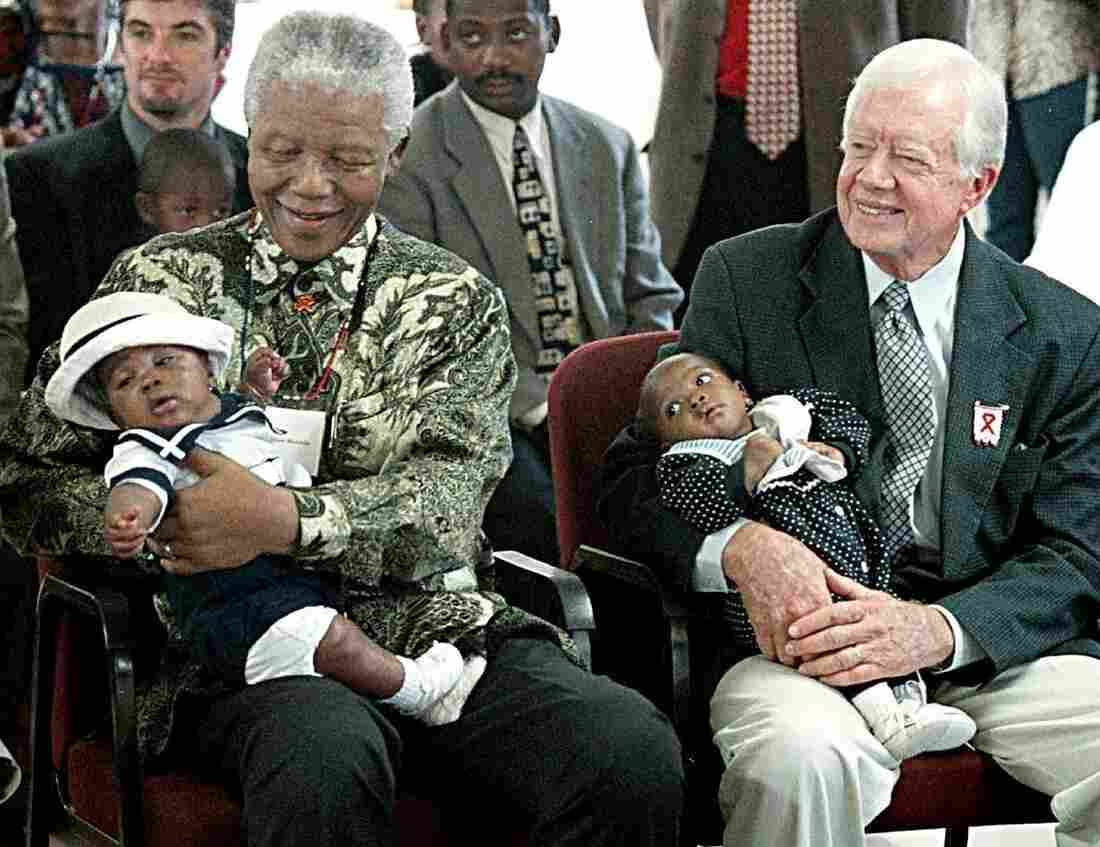 A long legacy in global health: Former President Jimmy Carter has worked to end neglected diseases since 1982. Here he sits with former South African President Nelson Mandela at a ceremony in Soweto, celebrating a new AIDS project in 2002.